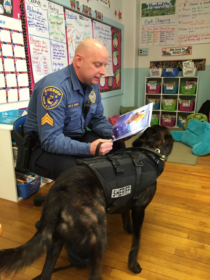 pic is Sgt. Brian Howarth and his partner Devante reading to children in Sherman School in Roselle Park.
