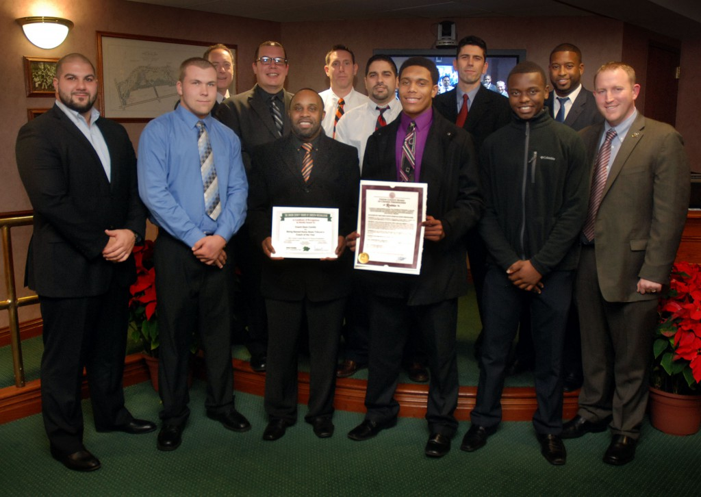 Union County Freeholder Chairman Christopher Hudak, Vice Chairman Mohamed Jalloh and Freeholder Bruce Bergen present a resolution to representatives of the Linden High School Football team congratulating them on winning the school's first football State Championship in 29 years. The Freeholders also honored Head Coach Deon Candia on being named the Home News Tribune's 2014 All-Area Football Coach of the Year. (Photo by Jim Lowney/County of Union)