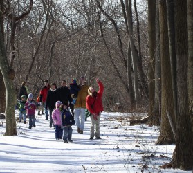 Trailside Naturalist Becky Novorro guides a group of visitors on a walk to search for animal homes and hideouts last winter
