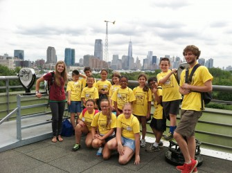 """Trailside Park Naturalist Becky Novorro and assistant Nicholas Gabuzda of Westfield pose in front of a windmill during a field trip to the Liberty Science Center in Jersey City as part of a week-long camp entitled """"The Green Team"""" for children entering 5th-6th grades"""