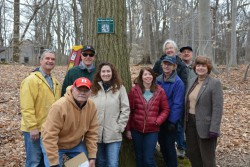 TAKING A BREAK...from installing new tree identification signs at Echo Lake Park, Union County Master Tree Stewards pose for a group shot.  The new signs link to an online virtual field guide that park users can access with their smartphones or tablets to learn more about the trees in the park.  The Tree Stewards recently finished a tree trail in Nomahegan Park and plan to hit Briant Park next.  Freeholder Bette Jane Kowalski, far right, watched the volunteers install the signs along the Echo Lake Path.  The Tree Stewards, from left to right, are: John Zebrowski, Dean Talcott, Jerry Petz, Sandy Ciasco, Ann Sharlow, Clare Minick, Gail and Charles Moizeau