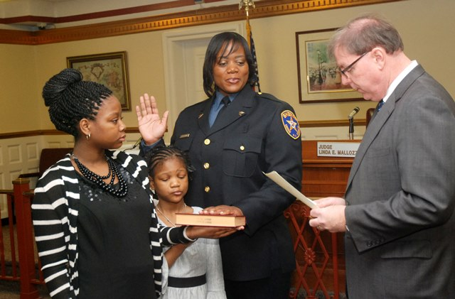 Veteran Sheriff's Officer Nakera Sherman is sworn in to her new rank of Sergeant by Union County Sheriff Joe Cryan with the help of her daughters Kayla (far l.) and Jada. Photo: Jim Lowney/County of Union.