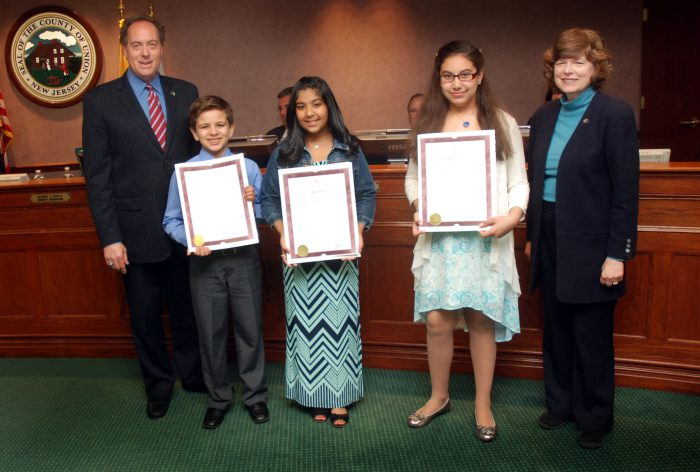 (From 2nd left) Sebastian Saavedra from the Robert Gordon Elementary School in Roselle Park won first place. Abigail George from the Jefferson School in Vauxhall won second place. Natalie Ortiz from #27 Dr. Antonia Pantoja School in Elizabeth won third place.