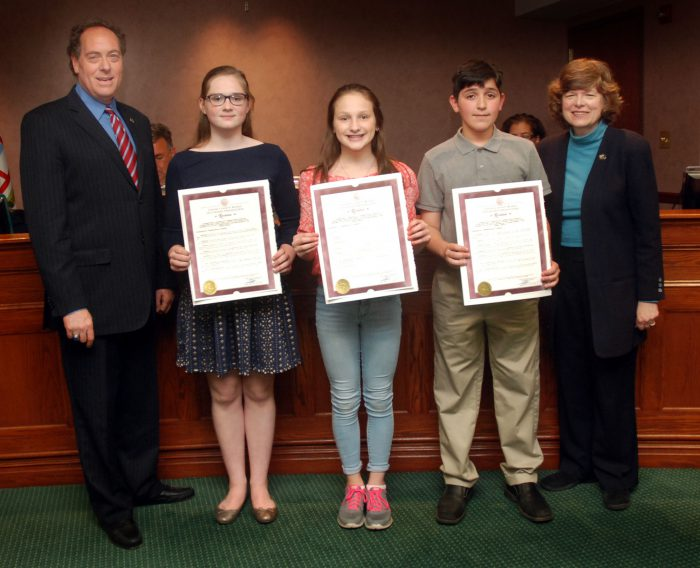 (From 2nd left) Martha Byrne from the Holy Trinity School in Westfield won first place. Emily Haines from the Columbia Middle School Berkeley Heights won second place. Andrew Figueroa from St. John the Apostle in Clark won third place.