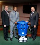 Union County Freeholder Chairman Bruce H. Bergen and Freeholders Mohamed S. Jalloh and Angel G. Estrada meet Curby the recycling robot. (Photo by Jim Lowney/County of Union)